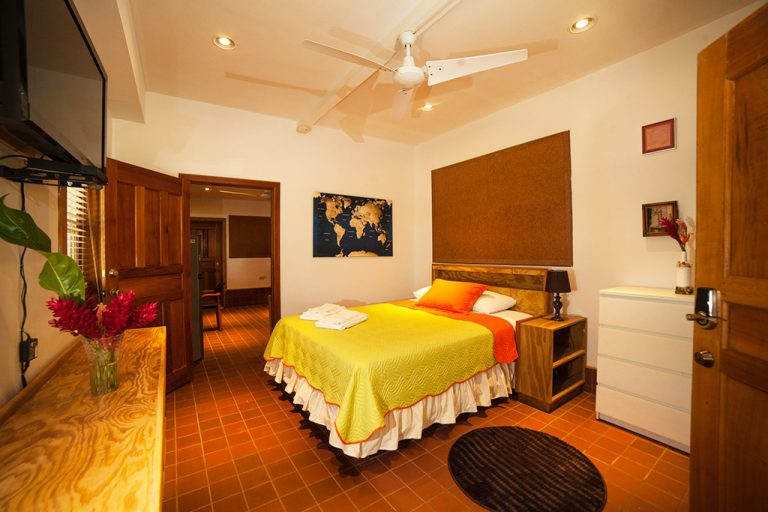 The queen size bed in Casa Escultura 1 is comfortable in one of the best apartments for rent in Bocas del Toro.