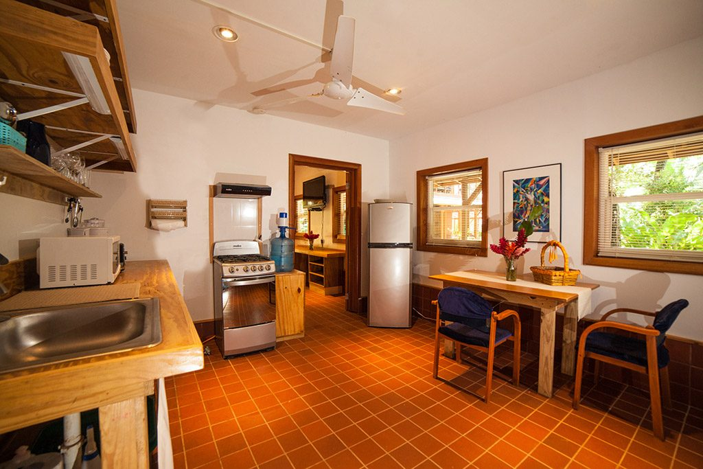 The one bedroom apartment for rent in bocas del toro features a spacious kitchen and dining area.