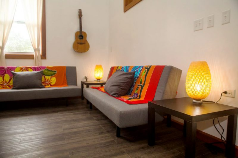 lounge seating area with guitar in bocas
